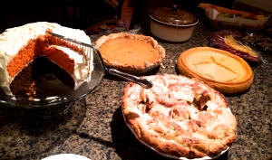 Pumpkin cheesecake, pumpkin pie, orange cake, chocolate cake, apple pie...